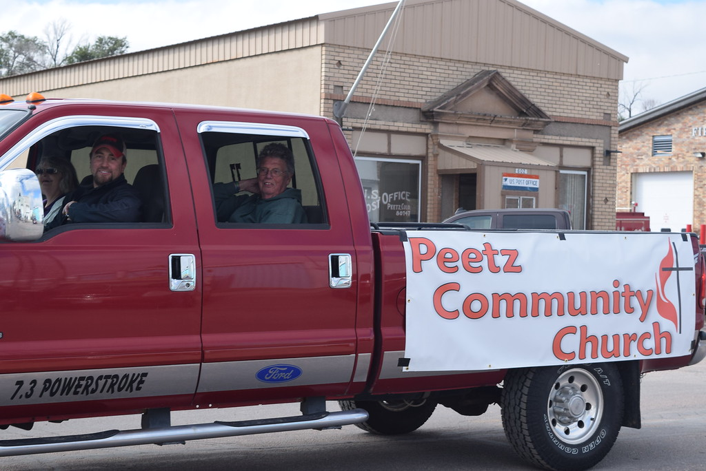 """. A float from Peetz Community Church makes its way down the parade route during the Peetz Sake Days \""""Still on the Hill\"""" Centennial Parade Saturday, Sept. 30, 2017."""