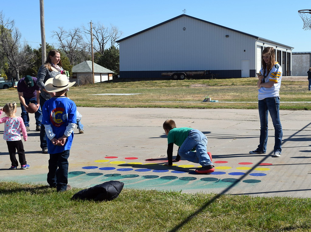 """. A game of Twister had youngsters twisting and turning at Peetz Sake Days \""""Still on the Hill\"""" Centennial Celebration Saturday, Sept. 30, 2017."""
