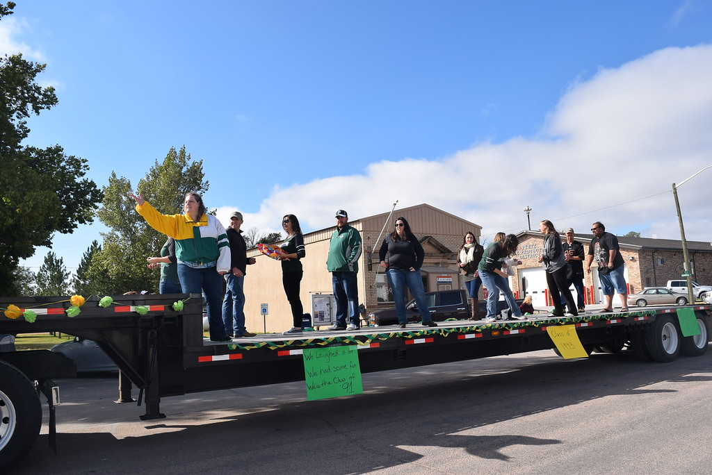 """. A float carrying members of the Peetz High School Classes of 1991, 1992 and 1993 makes its way down the parade route during the Peetz Sake Days \""""Still on the Hill\"""" Centennial Parade Saturday, Sept. 30, 2017."""