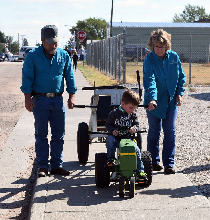 """. A youngster gives it his best as he tries to move the tractor forward in a peddle tractor pull at Peetz Sake Days \""""Still on the Hill\"""" Centennial Celebration Saturday, Sept. 30, 2017."""