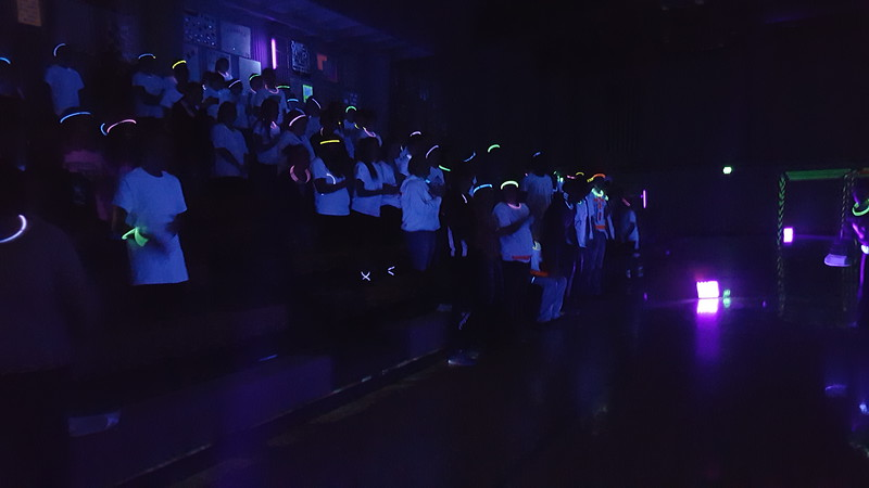 Students cheer on their classmates as they perform a dance during Merino Jr./Sr. High School's Neon Glow Energizer Afternoon Wednesday, Feb. 10, 2016.