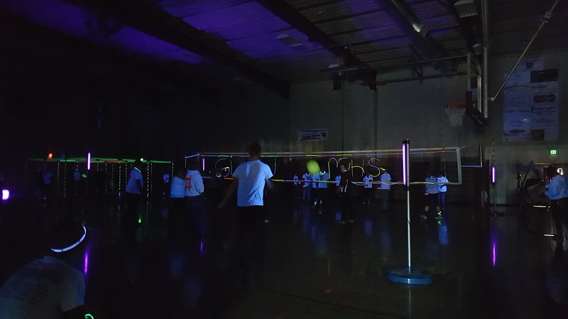 Students watch as two classes take each other on in a volleyball game during Merino Jr./Sr. High School's Neon Glow Energizer Afternoon Wednesday, Feb. 10, 2016.