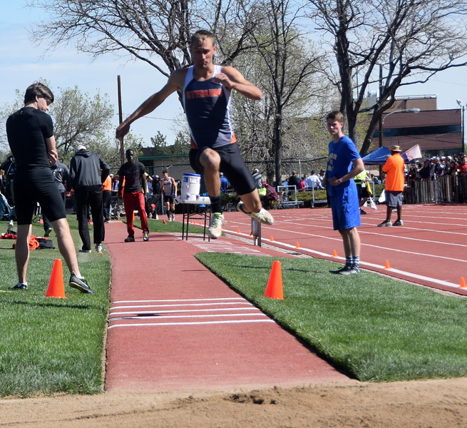 Sterling's Michael Chavez warms up for the triple jump