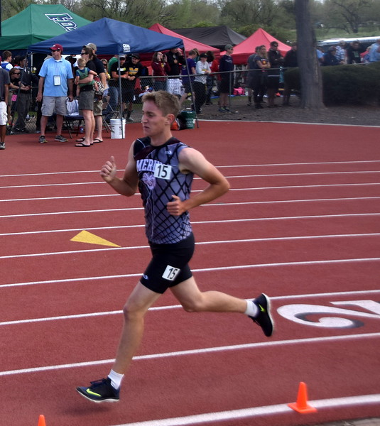 Zach Karg of Merino paces himself in the 1,600 meter run