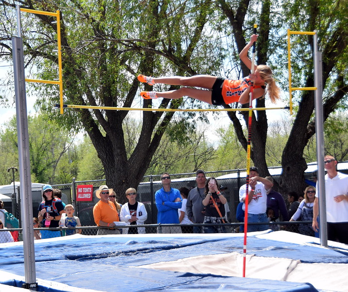 Sterling's Jenna Kellogg pushes herself over the bar during an attempt in the pole vault.