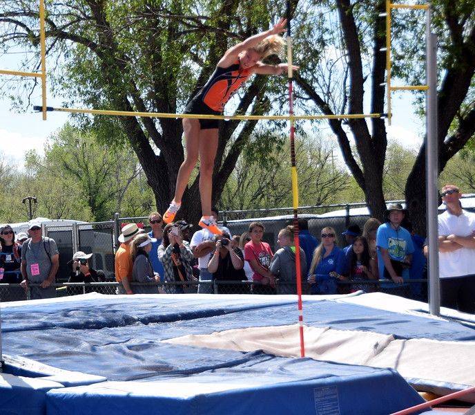Sterling's Jenna Kellogg tries not to hit the bar on the way down during an attempt in the pole vault.