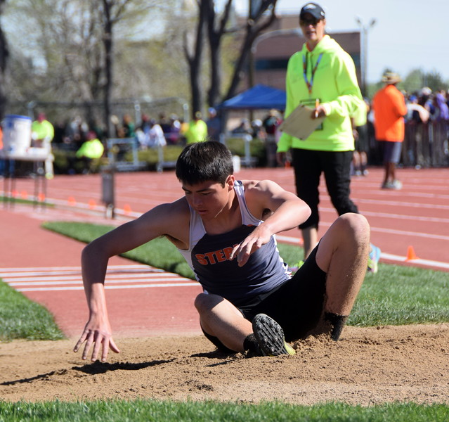 Sterling's Colton Shalla lands during an attempt in the long jump.
