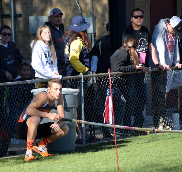 LiamSkerjanec focused on the competition while waiting his turn in the pole vault