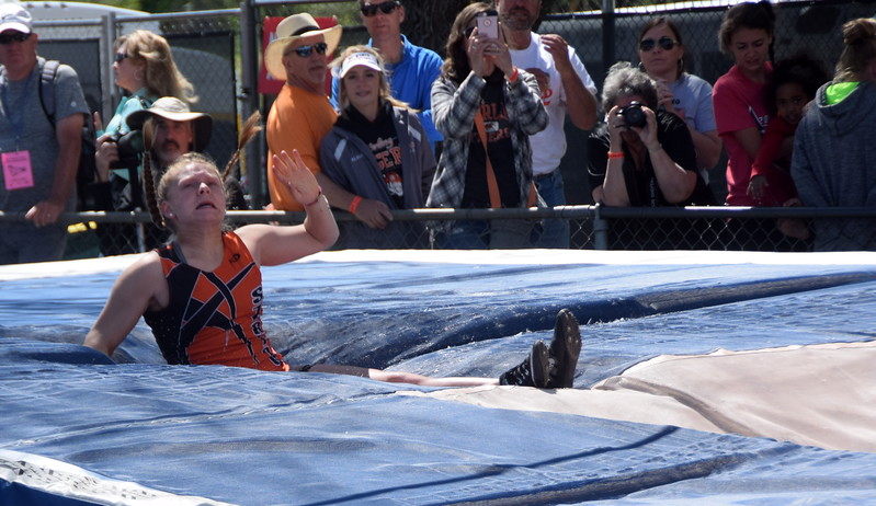 Sterling's Kaitlyn Maker hopes the bar stays up after an attempt in the pole vault.
