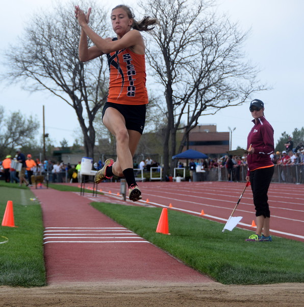 Sterling's Kylie Chavez flies through the air during an attempt in the triple jump.