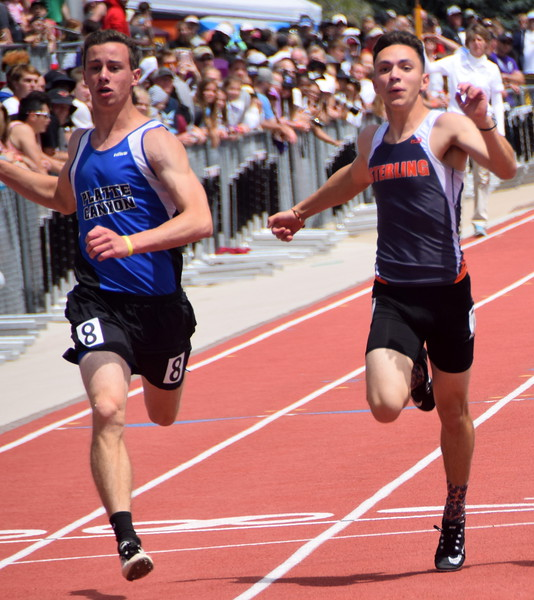 Sterling's Isaac Harris sprints during the 100 meter dash.