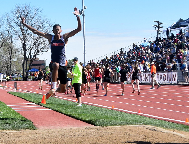 Sterling's Jayson Frank flies through the air during an attempt in the long jump.