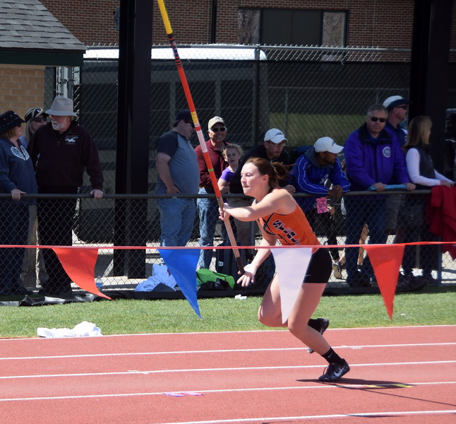 Sterling's Kaitlynn Prelle gains speed during an attempt in the pole vault.
