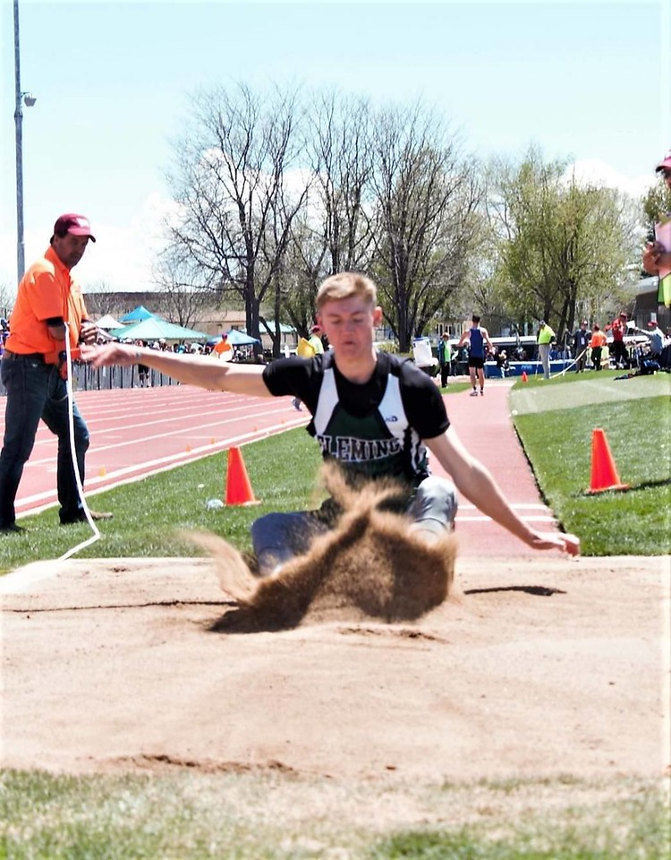 Fleming's Alex Vandenbark lands during an attempt in the long jump