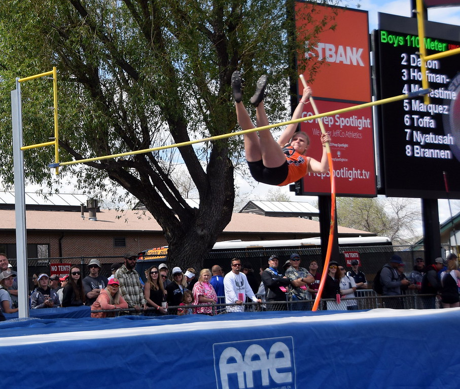 Sterling's Kaitlyn Maker attempts to get over the bar in the pole vault