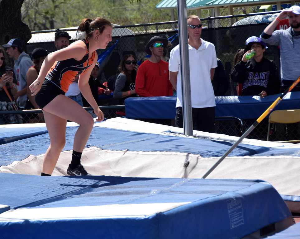 Sterling's Kaitlynn Prelle smiles after a successful attempt in the pole vault.