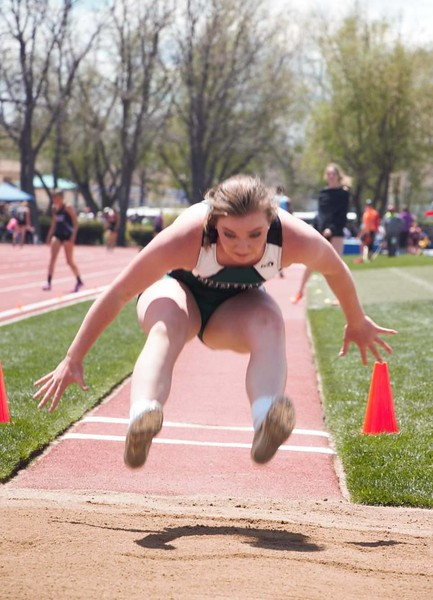 Fleming's Jenna Lengfelder stretches in an attempt in the long jump