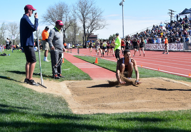 Jayson Frank of Sterling lands in an attempt in the triple jump