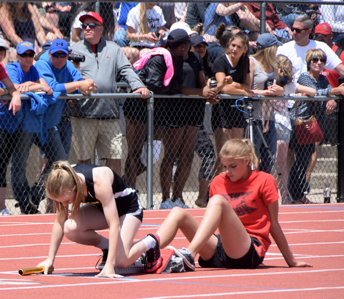 Caliche's Cristen Houghton sets up on the blocks in the 4x100 meter relay