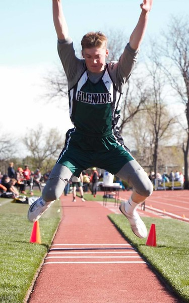 Alex Vandenbark flies through the air during an attempt in the long jump.
