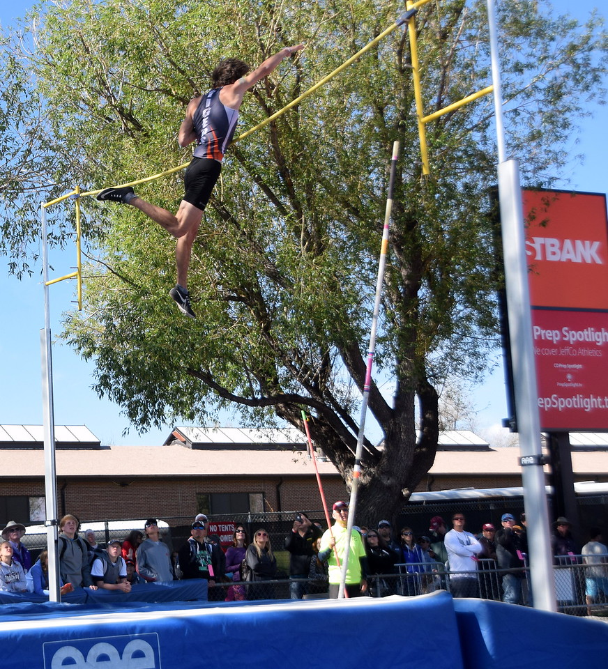 Sterling's Victor Zimmerman clears the bar during an attempt in the pole vault.