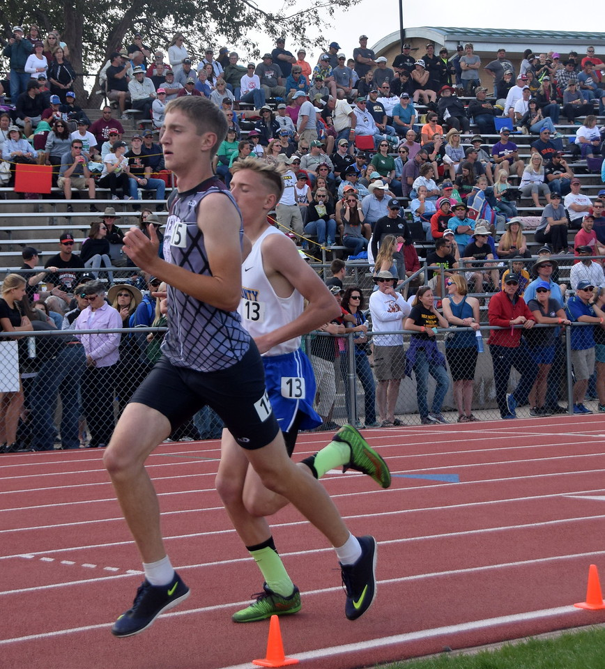 Merino's Zach Karg competes in the 1,600 meter run.