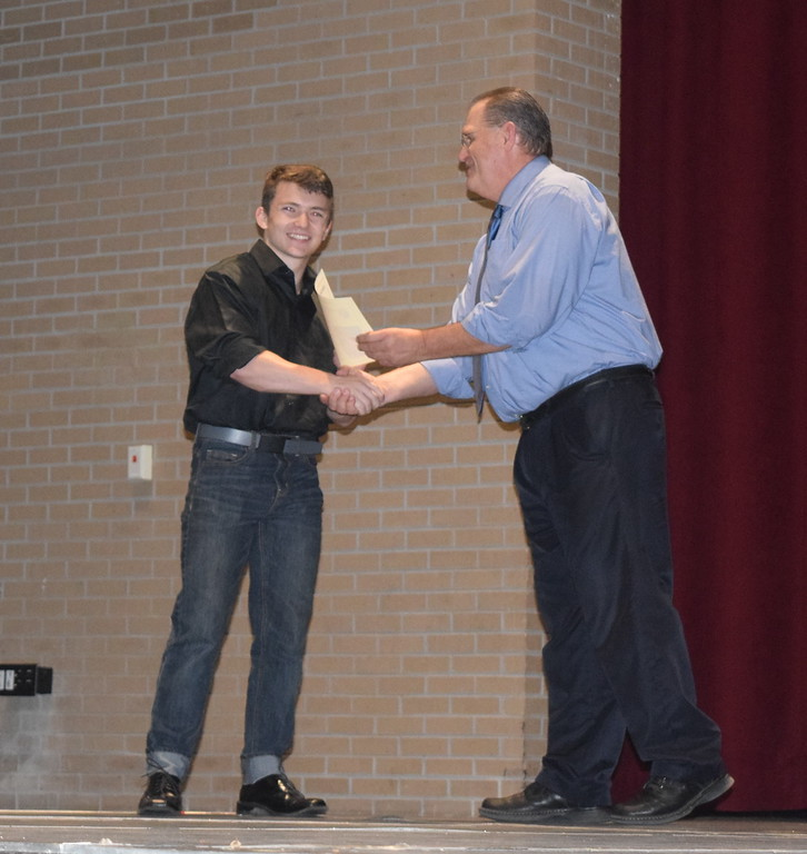 . Ethan Farquhar receives the Semper Fidelis Award for Musical Excellence from Sterling High School Principal Wally Beardsley at the school\'s Celebration of Academic Honors Tuesday, May 9, 2017.