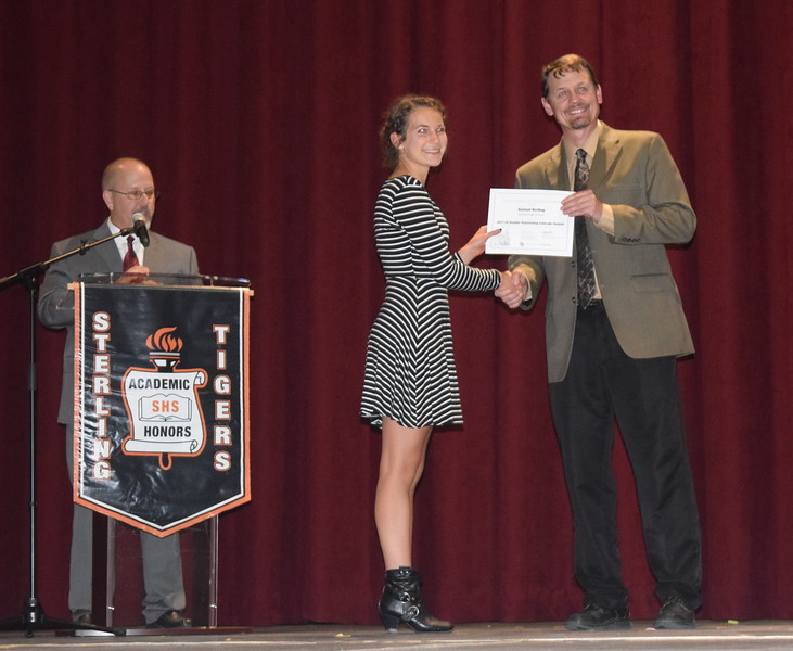 Mark Appelhans, assistant principal at Sterling High School, presents the as University of Colorado – Boulder's Outstanding Student Award to Rachael Northup at the school's Celebration of Academic Honors Tuesday, May 9, 2017.