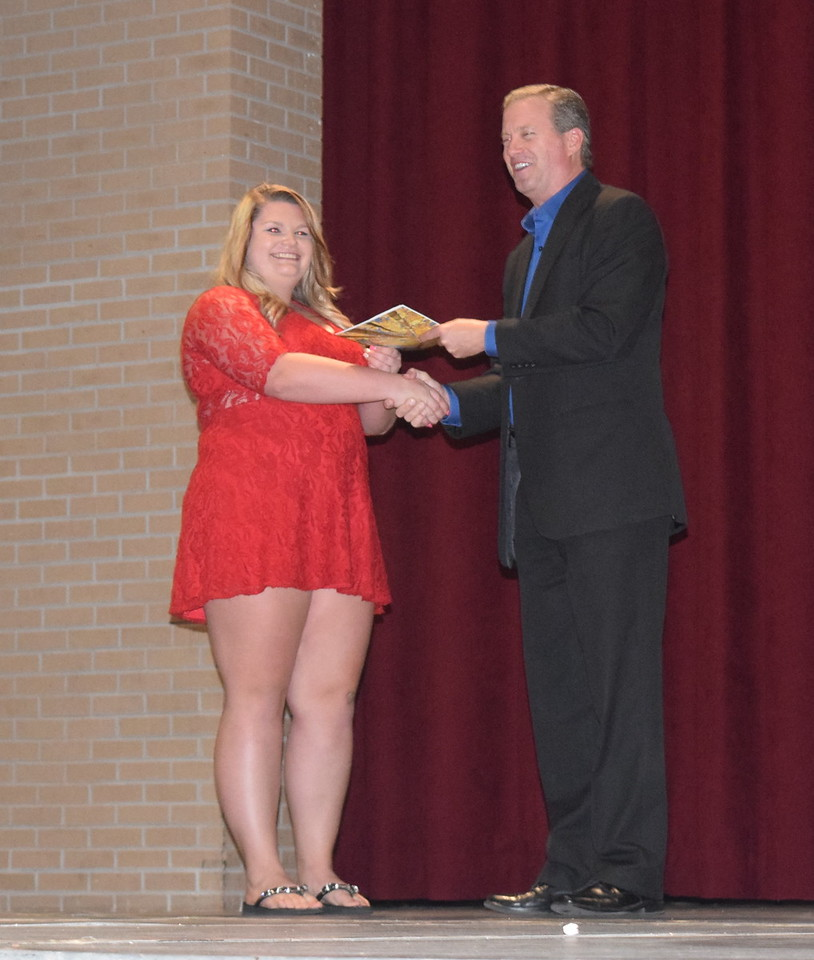 John Chapdelaine, director of the Eastern Colorado Community Foundation, presents the Ruth Henderson Memorial Scholarship to Abigail at Sterling High School's Celebration of Academic Honors Tuesday, May 9, 2017.