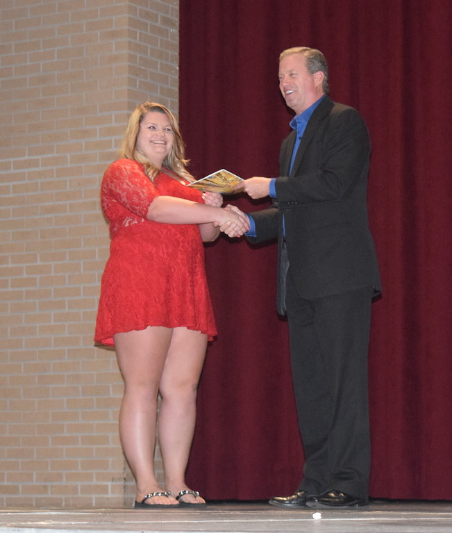 . John Chapdelaine, director of the Eastern Colorado Community Foundation, presents the Ruth Henderson Memorial Scholarship to Abigail at Sterling High School\'s Celebration of Academic Honors Tuesday, May 9, 2017.
