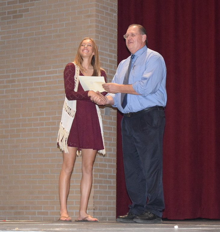 . Kylie Chavez receives the United States Marines Scholastic Excellence Award from Sterling High School Principal Wally Beardsley at the school\'s Celebration of Academic Honors Tuesday, May 9, 2017.
