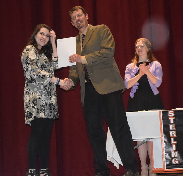 Scholarship recipient Alexx Allen receives her scholarships from Mark Appelhans, assistant principal at Sterling High School, during the school's Celebration of Academic Honors Tuesday, May 9, 2017.