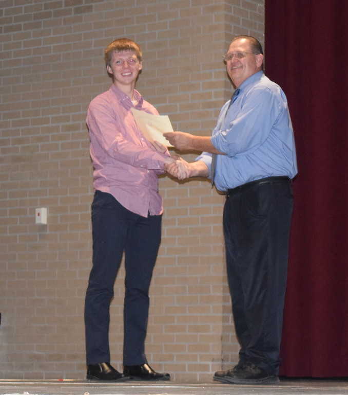 . Logan Kiefer receives the United States Marines Scholastic Excellence Award from Sterling High School Principal Wally Beardsley at the school\'s Celebration of Academic Honors Tuesday, May 9, 2017.