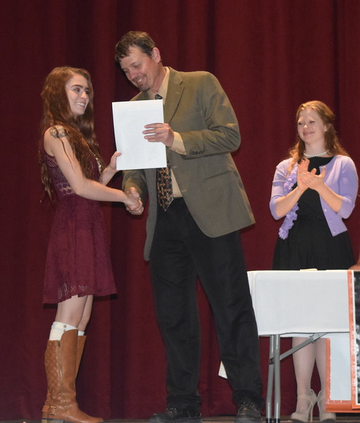 Scholarship recipient Tawny Atencio receives her scholarships from Mark Appelhans, assistant principal at Sterling High School, during the school's Celebration of Academic Honors Tuesday, May 9, 2017.