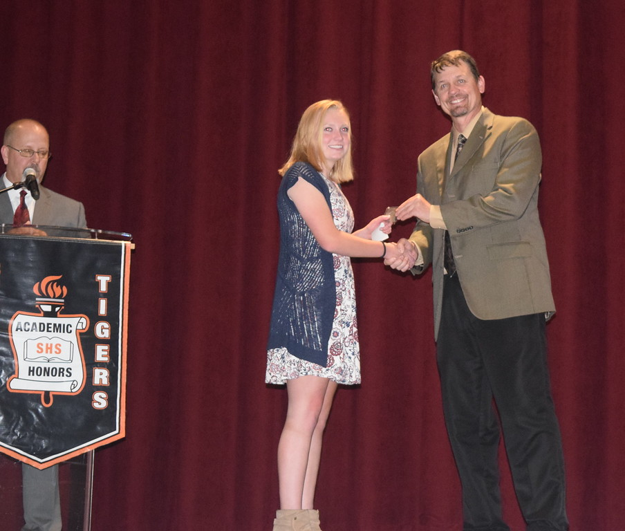 . Mark Appelhans, assistant principal at Sterling High School, presents the Colorado School of Mines Medal of Achievement in Math and Science award to Rebecca Miller at the school\'s Celebration of Academic Honors Thursday, May 9, 2017.
