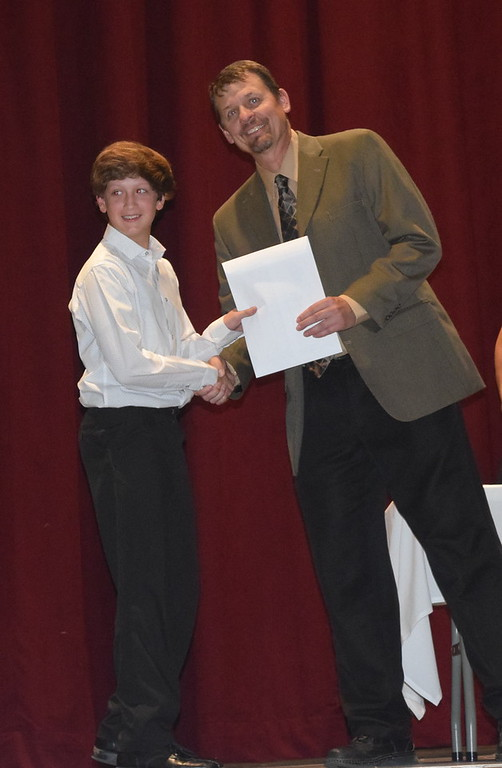 . Mark Appelhans, assistant principal at Sterling High School, presents an academic letter to freshman Dylan Cranwell at the Sterling High School\'s Celebration of Academic Honors Tuesday, May 9, 2017.