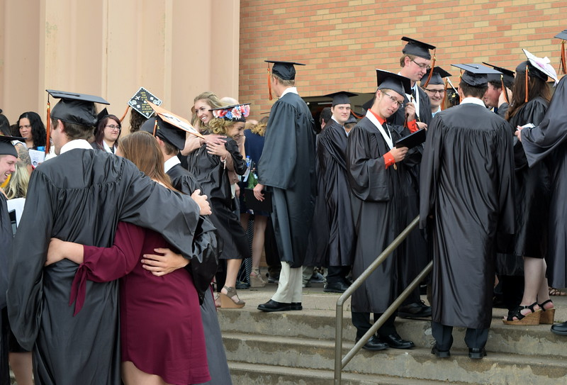 Sterling High School graduates congratulate each other following commencement exercises Saturday, May 27, 2017.