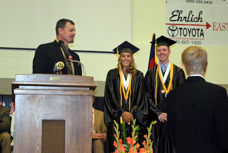 Mark Appelhans, Sterling High School assistant principal, recognizes Kylie Chavez and Logan Kiefer for having achieved a 4.0 grade point average or better throughout their four year's of high school during the school's commencement exercises Saturday, May 27, 2017.