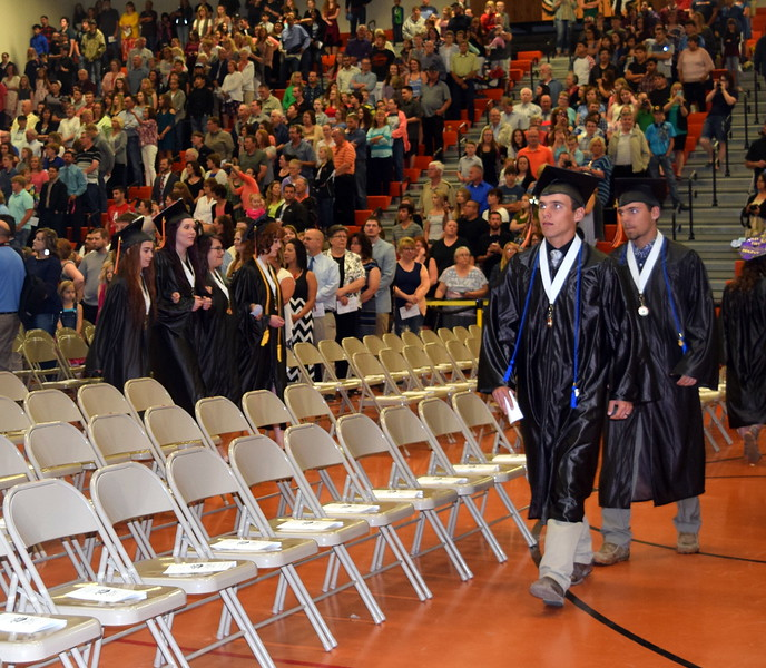 Sterling High School graduates proceed into Wally Post Gym at the start of commencement exercises Saturday, May 27, 2017.