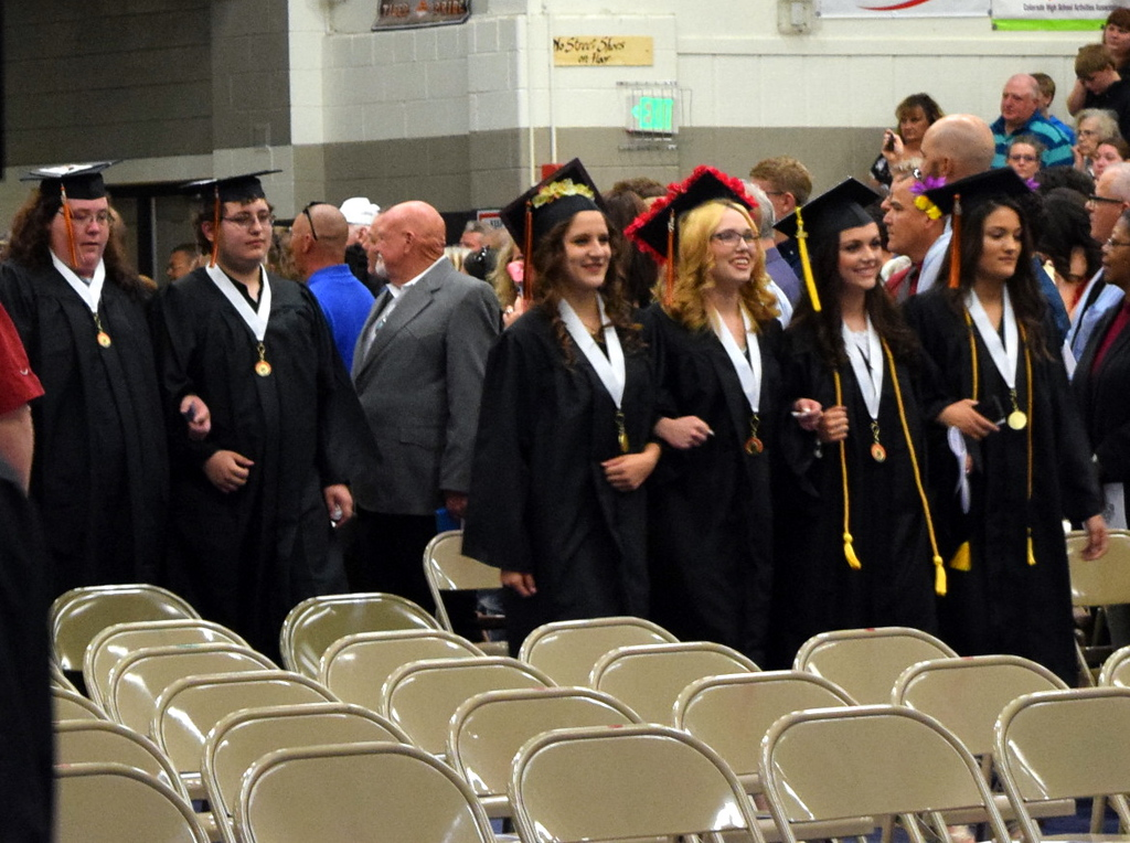 . Sterling High School graduates proceed into Wally Post Gym at the start of commencement exercises Saturday, May 26, 2018.