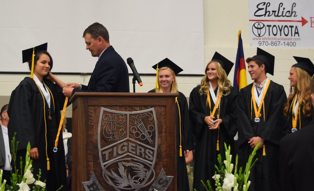 . Mark Appelhans, Sterling Hgh School assistant principal, presents medals to students a 4.00 grade point average or above throughout high school during the school\'s commencement exercises Saturday, May 26, 2018. From left; Rachael Northup, Rebecca Miller, Cassidy Paxton, Riley Schaefer and Kaitlyn Maker.
