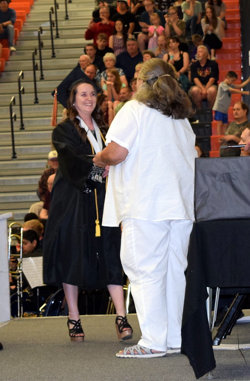 . Grace Reeves receives her diplioma from RE-1 Valley School Board member Riste Capps during commencement exercises Saturday, May 25, 2018.