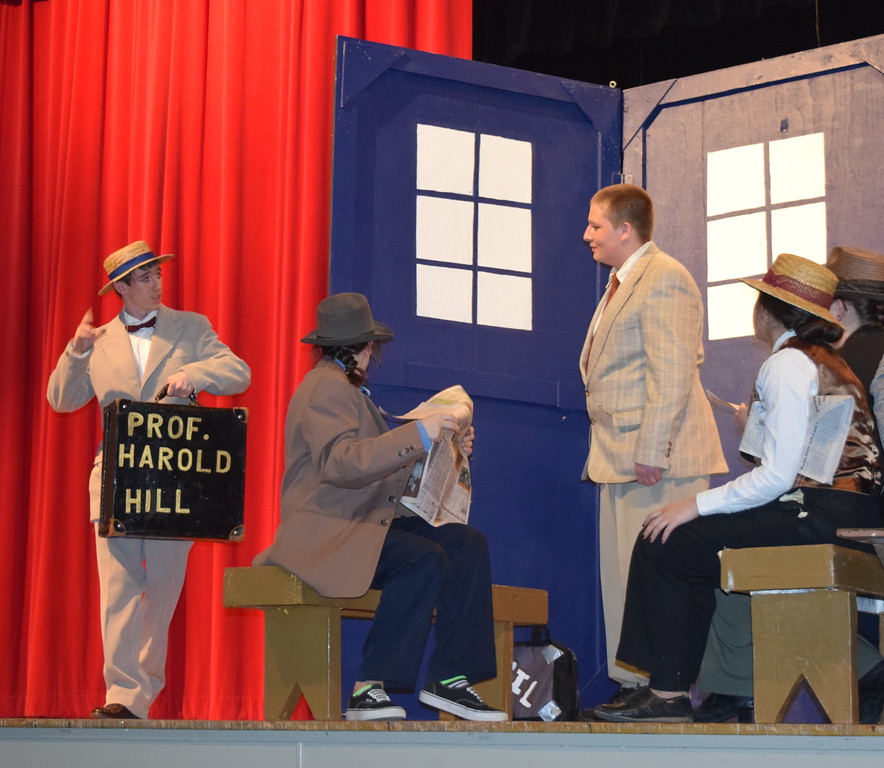 "Harold Hill (Clifford Farrington) meets up with another traveling salesman, Charlie Cowell (Calvin Hill) on the train to River City, Iowa, in a scene from Sterling High School's production of ""The Music Man."""