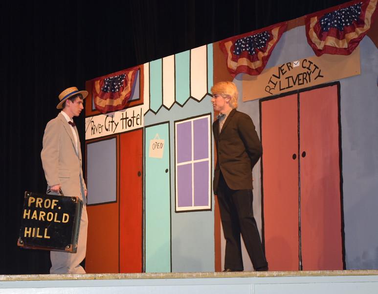 "Harold Hill (Clifford Farrington), right, runs into Olin Britt (Richard Tomlinson) in a scene from Sterling High School's production of ""The Music Man."""