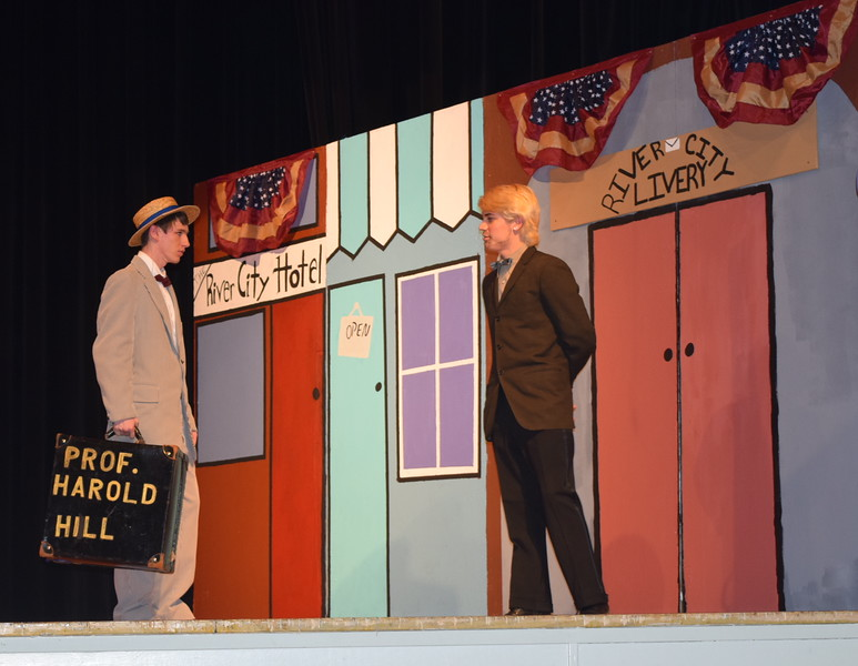 "Harold Hill (Clifford Farrington), right, runs into Olin Britt (Richard Tomlinson) in a scene from Sterling High School's production of ""The Music Man."""