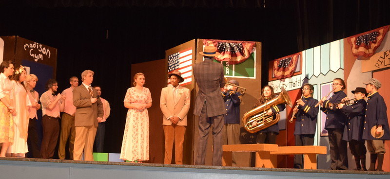 "The cast of Sterling High School's production of ""The Music Man"" rehearse a scene."
