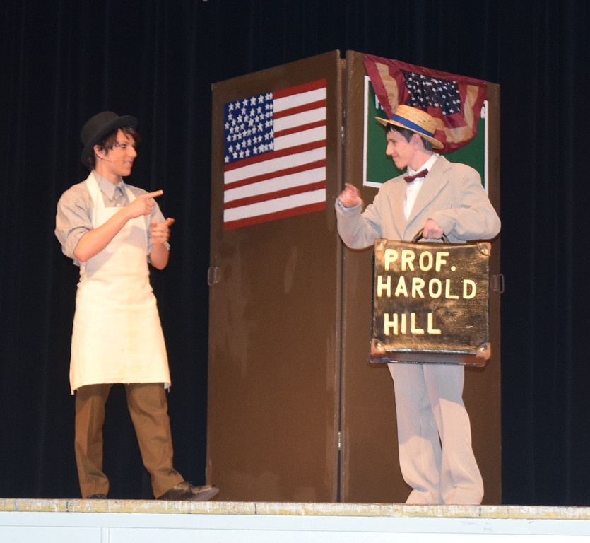 "Harold Hill (Clifford Farrington), right, talks with Marcellus Washburn (Jason Morales) during rehearsal for Sterling High School's production of ""The Music Man."""