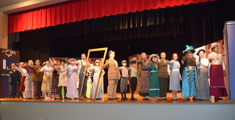 "The cast of Sterling High School's production of ""The Music Man"" perform a song, ""Iowa Stubb,"" during a rehearsal for the show."