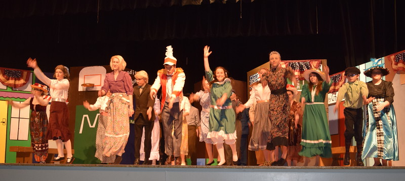 "The cast of Sterling High School's production of ""The Music Man"" rehearse a song, ""Seventy Six Trombones."""