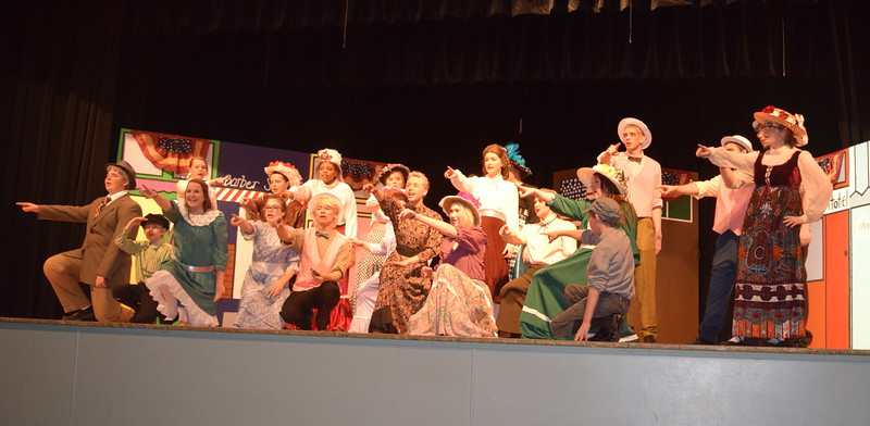 """The cast of Sterling High School's """"The Music Man"""" rehearses a scene from the show, which runs Thursday, April 7 through Saturday, April 9, 2016."""